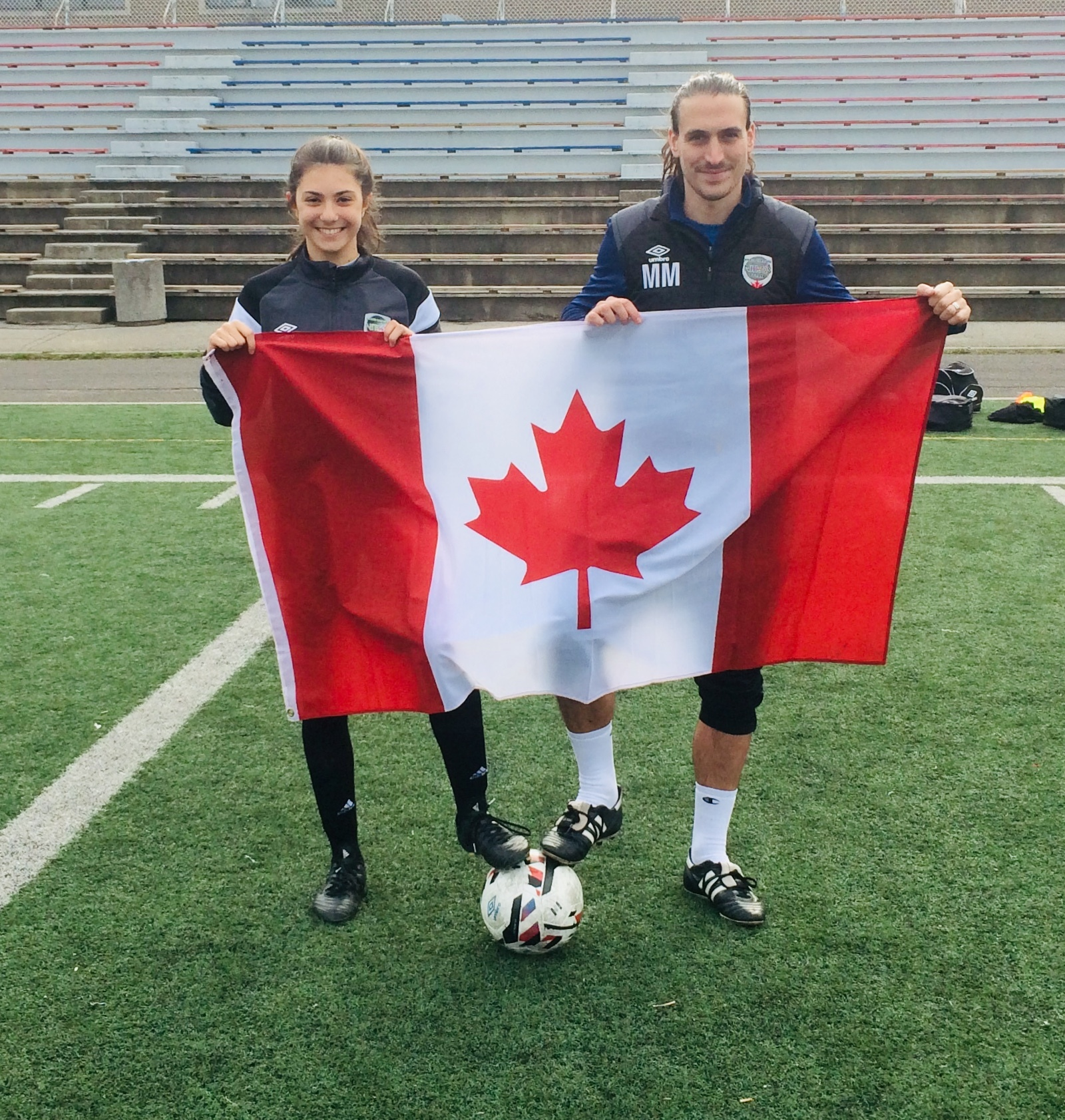 0d5f70ddc811 FLY THE FLAG...Olivia celebrates her call-up with her club coach Marc  Maunder at OPDL s opening outdoor practice this week